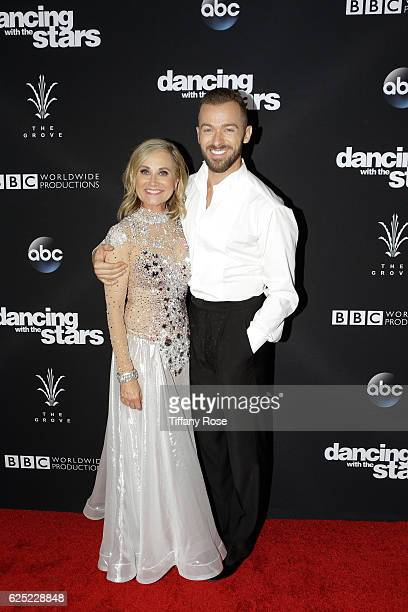 Actress Maureen McCormick and dancer Artem Chigvintsev attend the 'Dancing With The Stars' live finale at The Grove on November 22 2016 in Los...