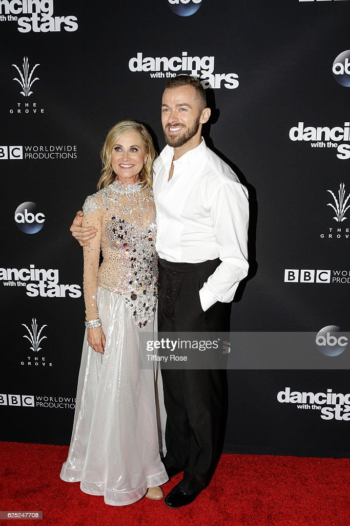 Actress Maureen McCormick and dancer Artem Chigvintsev attend the 'Dancing With The Stars' live finale at The Grove on November 22, 2016 in Los Angeles, California.