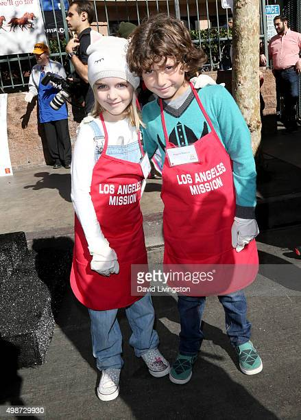 Actress McKenna Grace and actor August Maturo attend Thanksgiving for the Homeless at the Los Angeles Mission on November 25 2015 in Los Angeles...