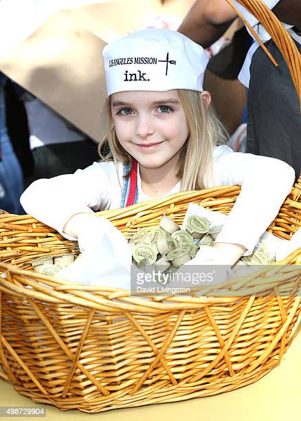 Actress McKenna Grace attends Thanksgiving for the Homeless at the Los Angeles Mission on November 25 2015 in Los Angeles California