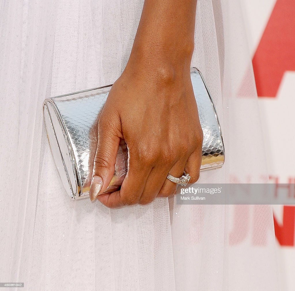 Actress Meagan Good (clutch and ring detail) at the premiere of 'Think Like A Man Too' at TCL Chinese Theatre on June 9, 2014 in Hollywood, California.