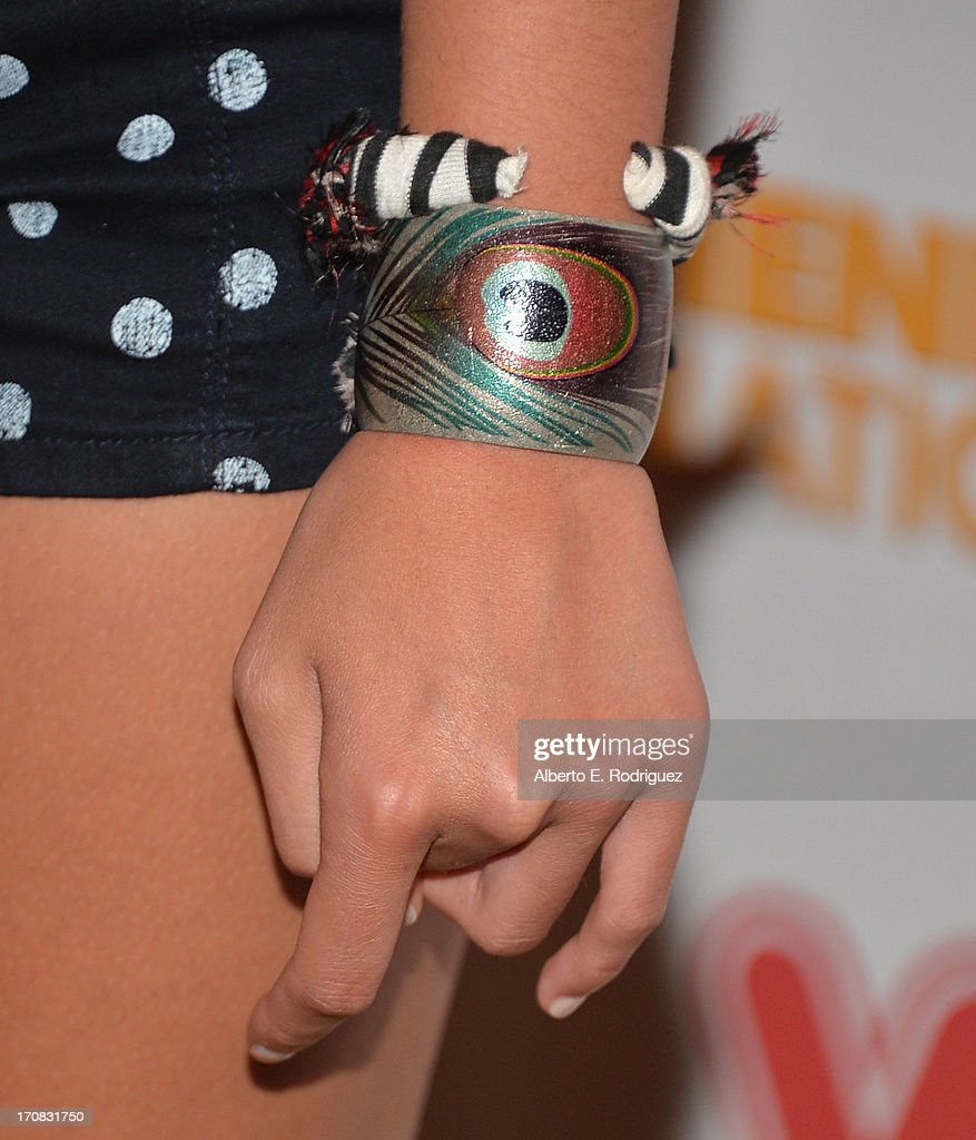 Actress Meg DeLacy (Bracelet detail) arrives to the Premiere of 'Wiener Dog Nationals' at Pacific Theatre at The Grove on June 18, 2013 in Los Angeles, California.