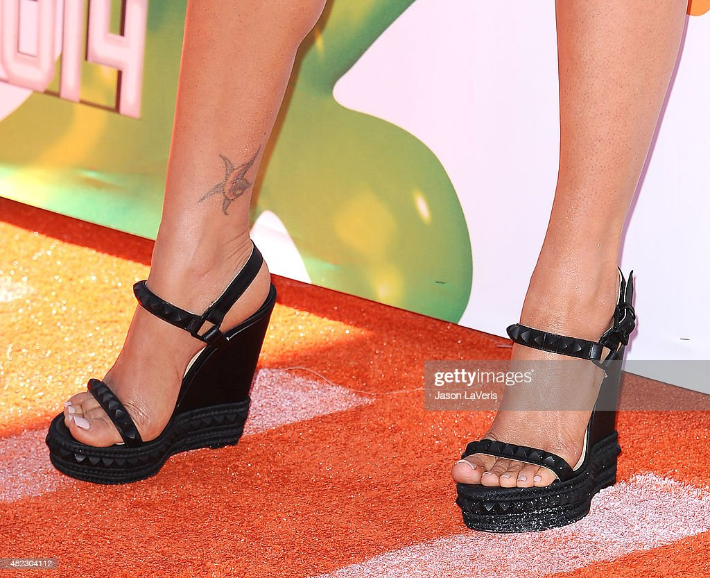 Actress Megan Fox (shoe and tattoo detail) attends the 2014 Nickelodeon Kids' Choice Sports Awards at Pauley Pavilion on July 17, 2014 in Los Angeles, California.