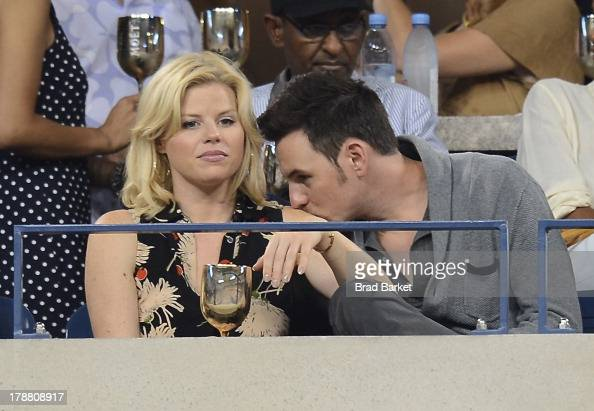Actress Megan Hilty and Brian Gallagher attend the Moet Chandon Suite at USTA Billie Jean King National Tennis Center on August 30 2013 in New York...