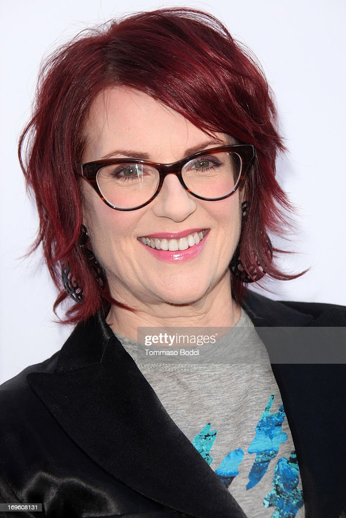 Actress <a gi-track='captionPersonalityLinkClicked' href=/galleries/search?phrase=Megan+Mullally&family=editorial&specificpeople=201612 ng-click='$event.stopPropagation()'>Megan Mullally</a> attends the 'The Kings Of Summer' Los Angeles premiere held at the ArcLight Hollywood on May 28, 2013 in Hollywood, California.