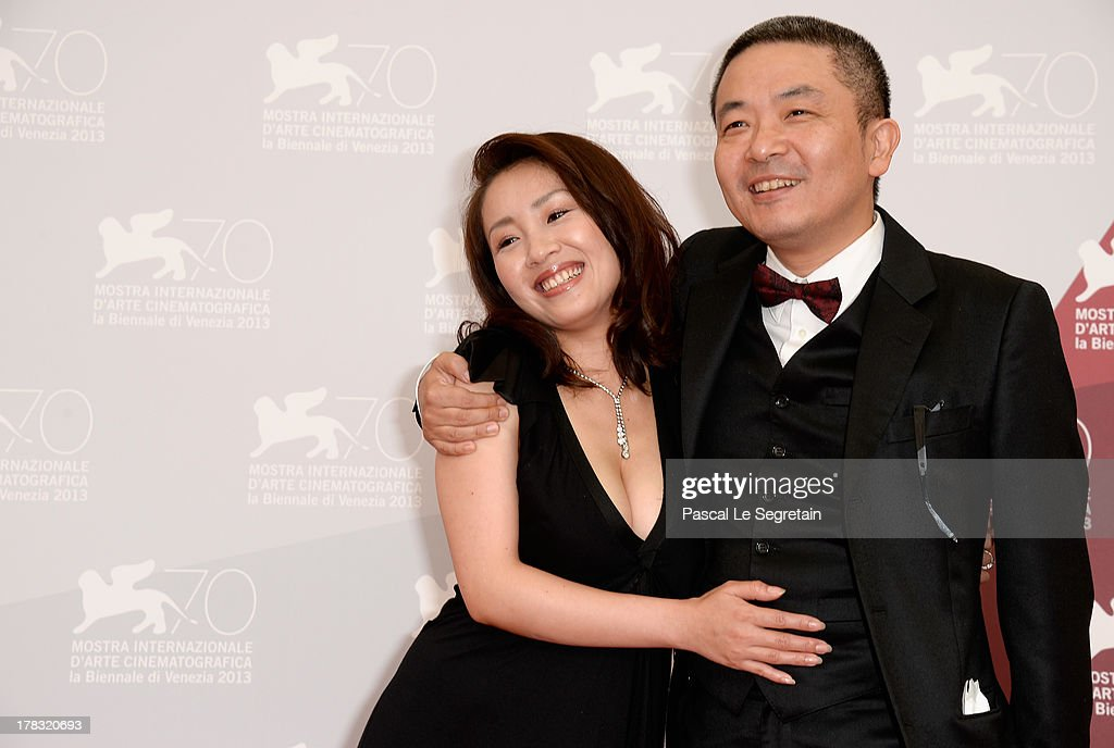 Actress <a gi-track='captionPersonalityLinkClicked' href=/galleries/search?phrase=Megumi+Kagurazaka&family=editorial&specificpeople=7793958 ng-click='$event.stopPropagation()'>Megumi Kagurazaka</a> and director <a gi-track='captionPersonalityLinkClicked' href=/galleries/search?phrase=Sion+Sono&family=editorial&specificpeople=6541524 ng-click='$event.stopPropagation()'>Sion Sono</a> attends the 'Why Don't You Play In Hell?' Photocall during the 70th Venice International Film Festivalon August 29, 2013 in Venice, Italy.