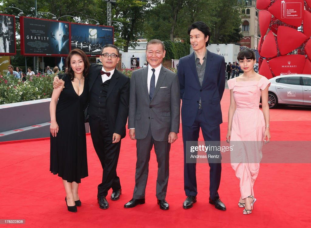 Actress <a gi-track='captionPersonalityLinkClicked' href=/galleries/search?phrase=Megumi+Kagurazaka&family=editorial&specificpeople=7793958 ng-click='$event.stopPropagation()'>Megumi Kagurazaka</a>, director <a gi-track='captionPersonalityLinkClicked' href=/galleries/search?phrase=Sion+Sono&family=editorial&specificpeople=6541524 ng-click='$event.stopPropagation()'>Sion Sono</a>, actors <a gi-track='captionPersonalityLinkClicked' href=/galleries/search?phrase=Jun+Kunimura&family=editorial&specificpeople=4599234 ng-click='$event.stopPropagation()'>Jun Kunimura</a>, <a gi-track='captionPersonalityLinkClicked' href=/galleries/search?phrase=Hiroki+Hasegawa&family=editorial&specificpeople=11310455 ng-click='$event.stopPropagation()'>Hiroki Hasegawa</a> and <a gi-track='captionPersonalityLinkClicked' href=/galleries/search?phrase=Fumi+Nikaido&family=editorial&specificpeople=8200734 ng-click='$event.stopPropagation()'>Fumi Nikaido</a> attend 'Why Don't You Play In Hell?' premiere during the 70th Venice International Film Festival on August 29, 2013 in Venice, Italy.