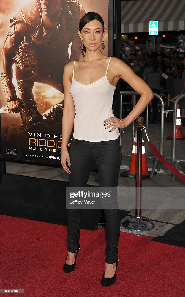Actress Mei Melancon arrives at the Los Angeles premiere of 'Riddick' at the Westwood Village Theatre on August 28, 2013 in Westwood, California.