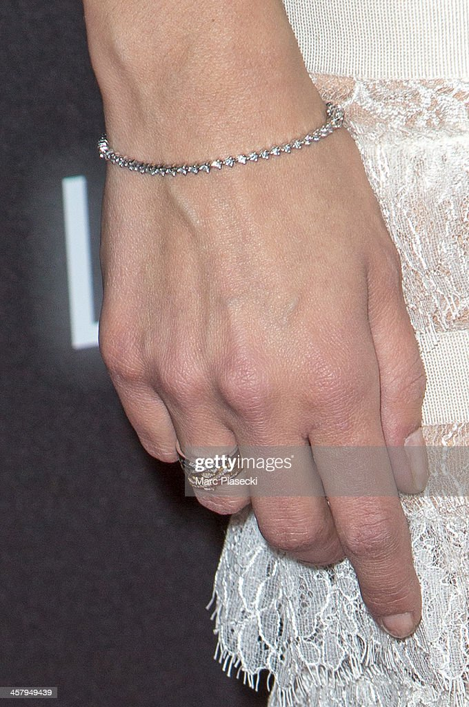 Actress Melanie Doutey (bracelet detail) attends the 'Jamais le premier soir' Premiere on December 19, 2013 in Paris, France.