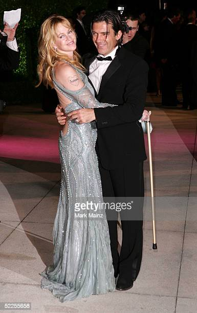 Actress Melanie Griffith and Actor Antonio Banderas arrive at the Vanity Fair Oscar Party at Mortons on February 27 2005 in West Hollywood California