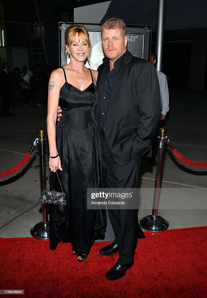 Actress <a gi-track='captionPersonalityLinkClicked' href=/galleries/search?phrase=Melanie+Griffith&family=editorial&specificpeople=171682 ng-click='$event.stopPropagation()'>Melanie Griffith</a> (L) and actor Michael Cudlitz arrive at the premiere of 'Dark Tourist' at ArcLight Hollywood on August 14, 2013 in Hollywood, California.