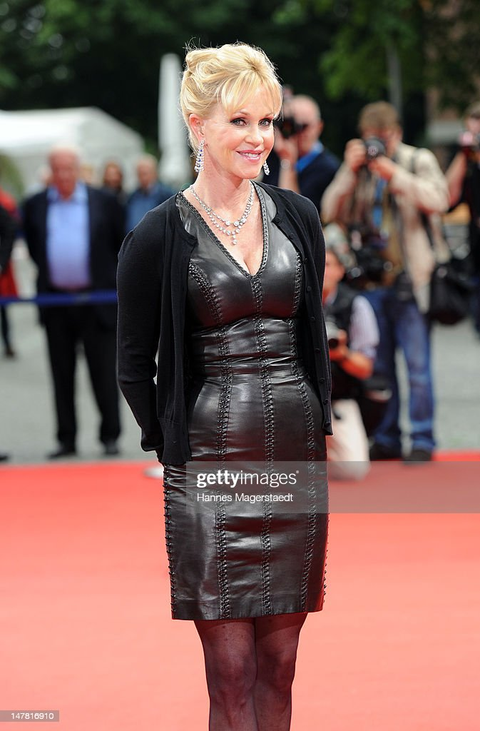 US actress <a gi-track='captionPersonalityLinkClicked' href=/galleries/search?phrase=Melanie+Griffith&family=editorial&specificpeople=171682 ng-click='$event.stopPropagation()'>Melanie Griffith</a> arrives at the Cine Merit Award during the Munich film festival on July 3, 2012 in Munich, Germany.