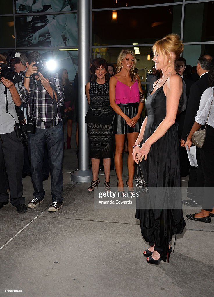 Actress Melanie Griffith arrives at the premiere of 'Dark Tourist' at ArcLight Hollywood on August 14, 2013 in Hollywood, California.