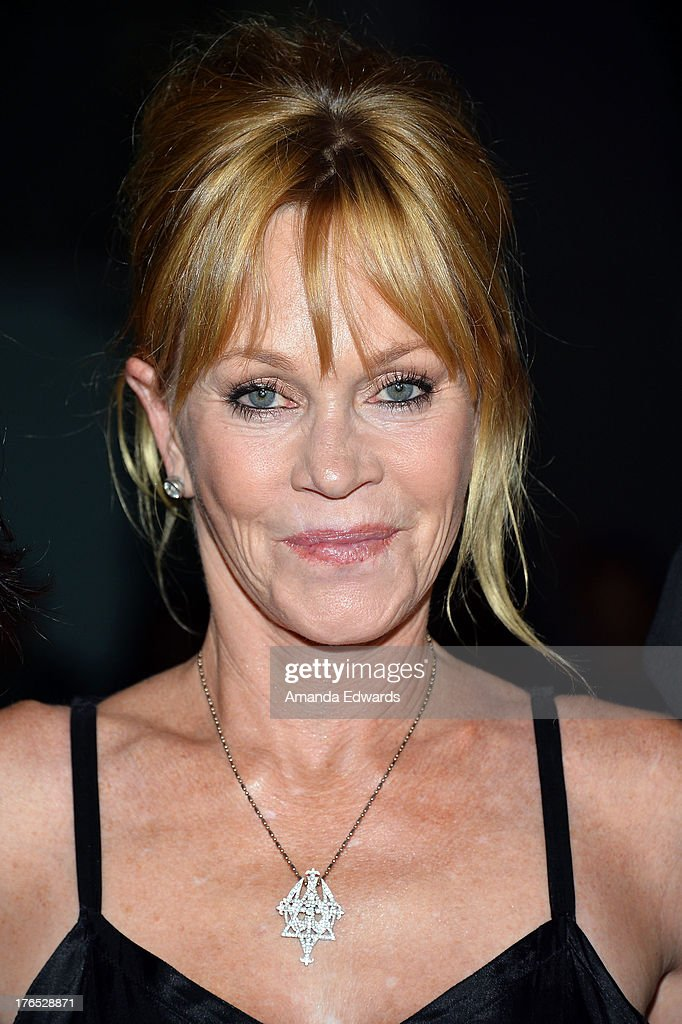 Actress Melanie Griffith arrives at the premiere of 'Dark Tourist' at ArcLight Hollywood on August 14 2013 in Hollywood California