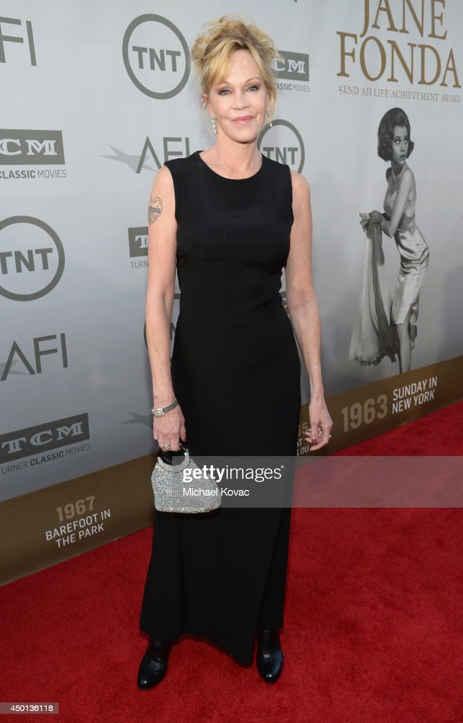 Actress <a gi-track='captionPersonalityLinkClicked' href=/galleries/search?phrase=Melanie+Griffith&family=editorial&specificpeople=171682 ng-click='$event.stopPropagation()'>Melanie Griffith</a> attends the 2014 AFI Life Achievement Award: A Tribute to Jane Fonda at the Dolby Theatre on June 5, 2014 in Hollywood, California. Tribute show airing Saturday, June 14, 2014 at 9pm ET/PT on TNT.