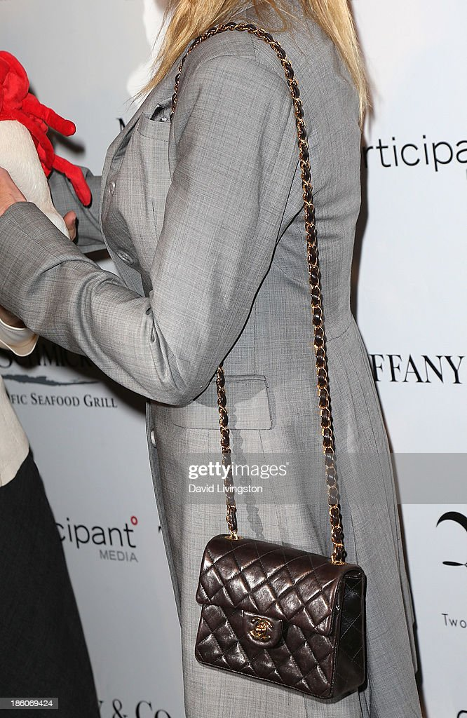Actress Melanie Griffith (purse detail) attends the Amanda Foundation's Annual Bow Wow Beverly Hills Halloween event at Two Rodeo on October 27, 2013 in Beverly Hills, California.