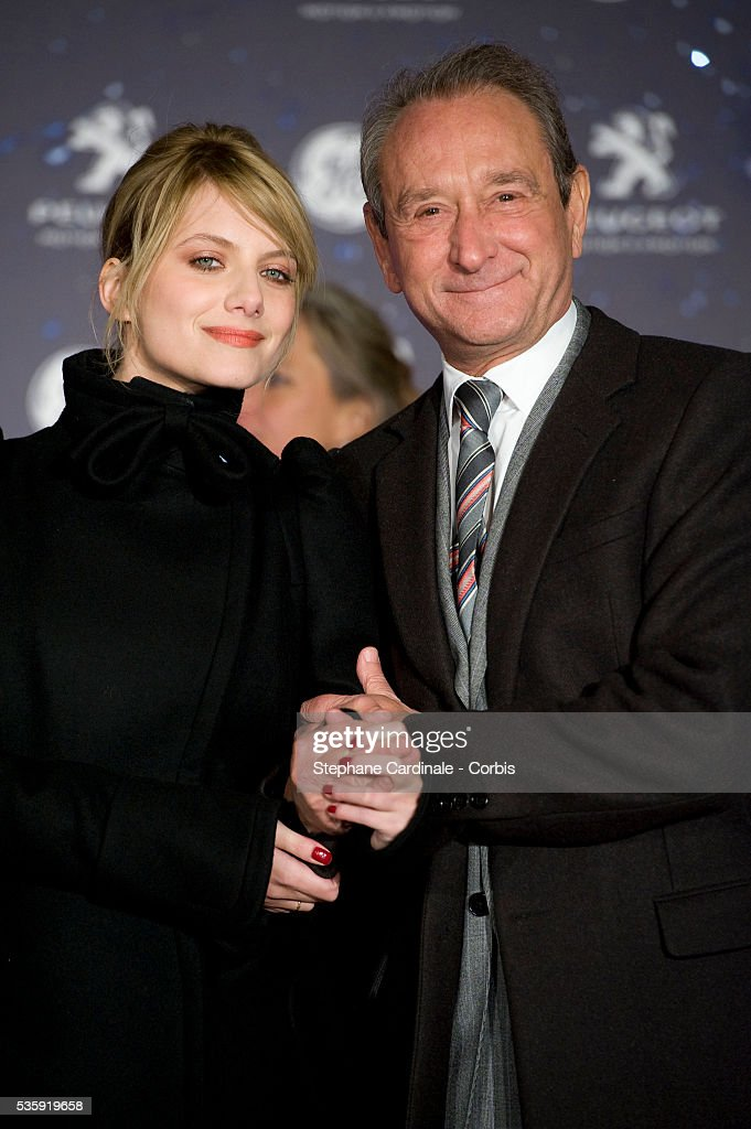 Actress Melanie Laurent (L) and Mayor of Paris Bertrand Delanoe (R) attend the Christmas Illumination 2010 launch on Champs-Elysees in Paris.