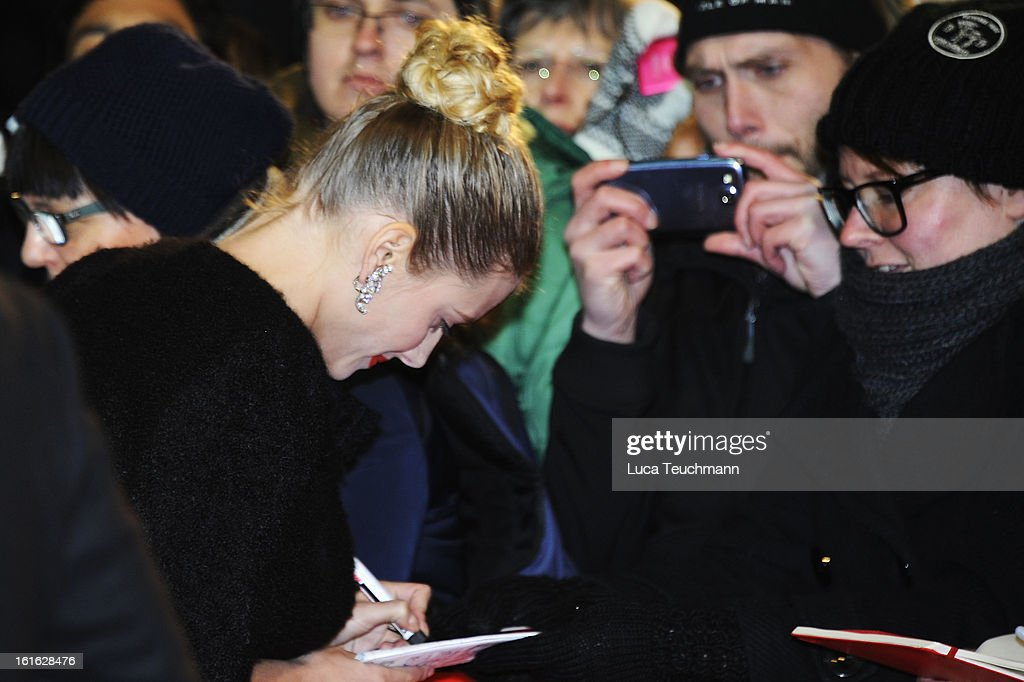 Actress Melanie Laurent signs autrographs as she attends the 'Night Train to Lisbon' Premiere during the 63rd Berlinale International Film Festival at the Berlinale Palast on February 13, 2013 in Berlin, Germany.