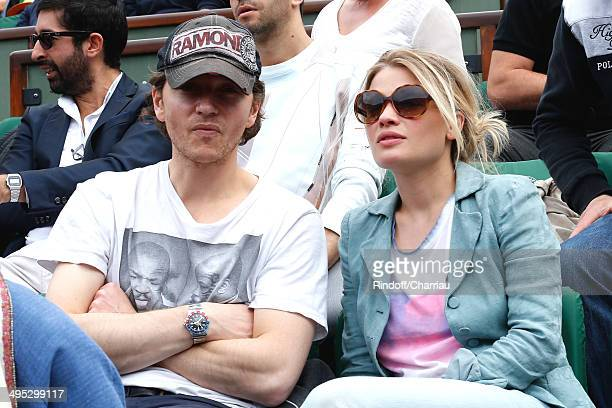 Actress Melanie Thierry and her companion singer Raphael attend the Roland Garros French Tennis Open 2014 Day 9 on June 2 2014 in Paris France