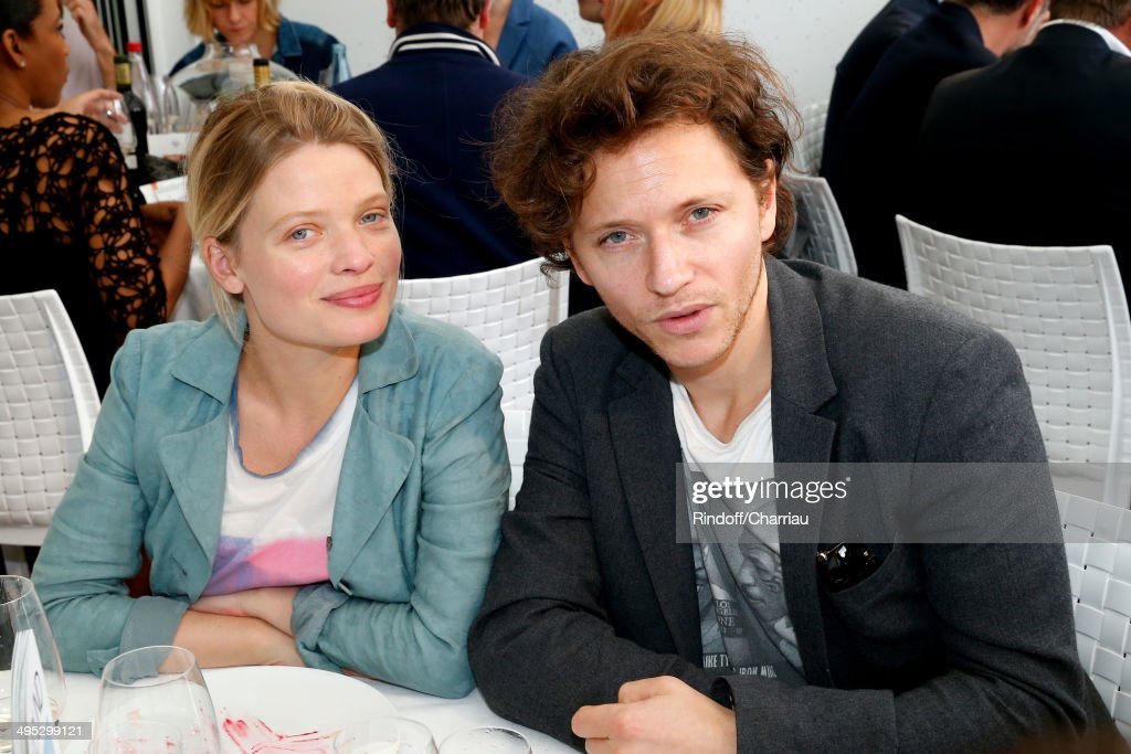 Actress <a gi-track='captionPersonalityLinkClicked' href=/galleries/search?phrase=Melanie+Thierry&family=editorial&specificpeople=591332 ng-click='$event.stopPropagation()'>Melanie Thierry</a> (R) and her companion singer Raphael attend the Roland Garros French Tennis Open 2014 - Day 9 on June 2, 2014 in Paris, France.