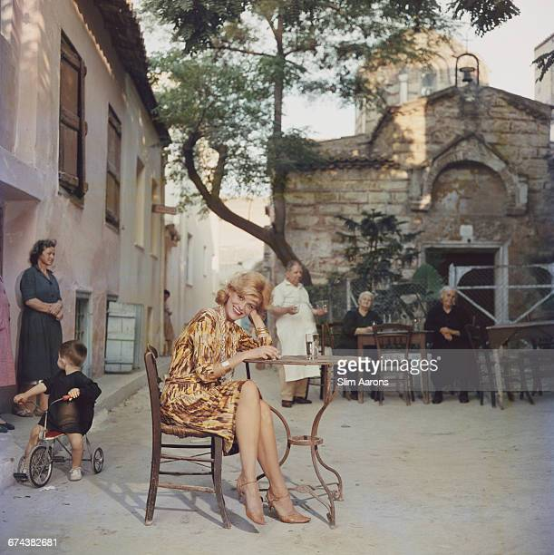 Actress Melina Mercouri enjoys a coffee and a cigarette at a quiet pavement cafe Plaka Athens 1961