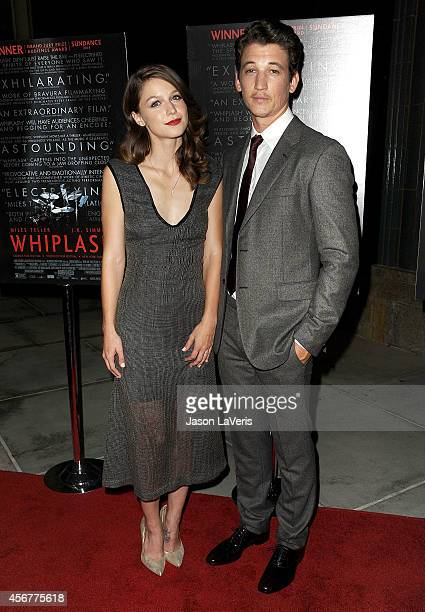 Actress Melissa Benoist and actor Miles Teller attend the premiere of 'Whiplash' at Bing Theatre At LACMA on October 6 2014 in Los Angeles California