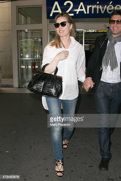 Actress Melissa George and her husband JeanDavid Blanc are seen at Nice airport during the 68th annual Cannes Film Festival on May 15 2015 in Cannes...