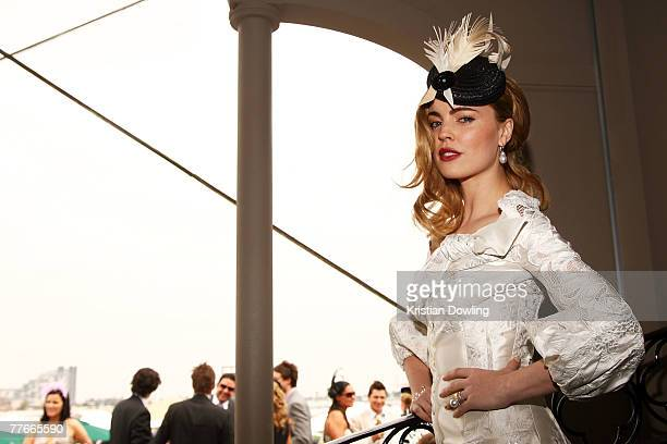 Actress Melissa George poses at the Myer Marquee on the first day of the Melbourne Cup Carnival Derby Day at Flemington Race Course on November 3...
