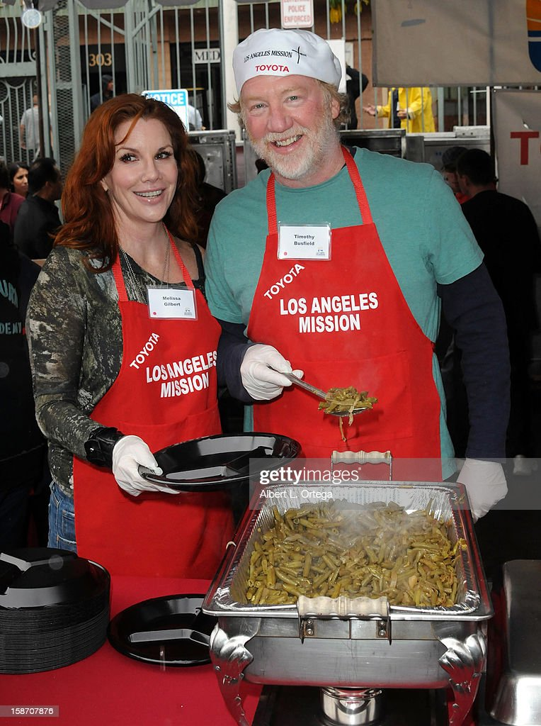 Actress Melissa Gilbert and actor Timothy Busfield participate in the Los Angeles Mission Christmas Eve lunch For The Homeless held at the Los Angeles Mission on December 24, 2012 in Los Angeles, California.