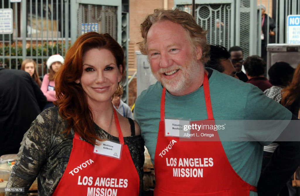 Actress <a gi-track='captionPersonalityLinkClicked' href=/galleries/search?phrase=Melissa+Gilbert&family=editorial&specificpeople=203284 ng-click='$event.stopPropagation()'>Melissa Gilbert</a> and actor <a gi-track='captionPersonalityLinkClicked' href=/galleries/search?phrase=Timothy+Busfield&family=editorial&specificpeople=744997 ng-click='$event.stopPropagation()'>Timothy Busfield</a> participate in the Los Angeles Mission Christmas Eve lunch For The Homeless held at the Los Angeles Mission on December 24, 2012 in Los Angeles, California.