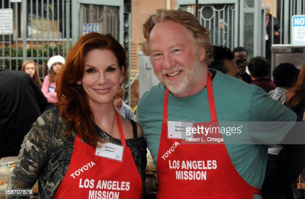 Actress Melissa Gilbert and actor Timothy Busfield participate in the Los Angeles Mission Christmas Eve lunch For The Homeless held at the Los...
