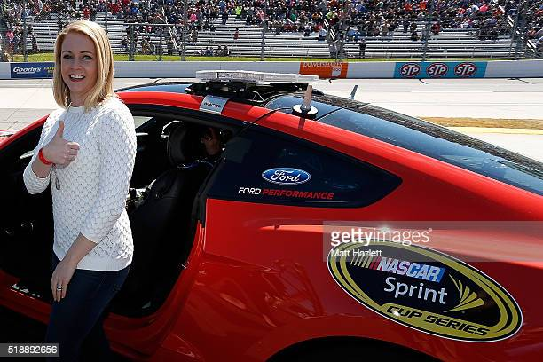 Actress Melissa Joan Hart prepares to enter the pace car prior to the NASCAR Sprint Cup Series STP 500 at Martinsville Speedway on April 3 2016 in...