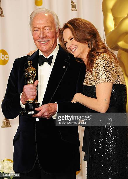 Actress Melissa Leo poses with actor Christopher Plummer winner of the Best Supporting Actor Award for 'Beginners' in the press room at the 84th...