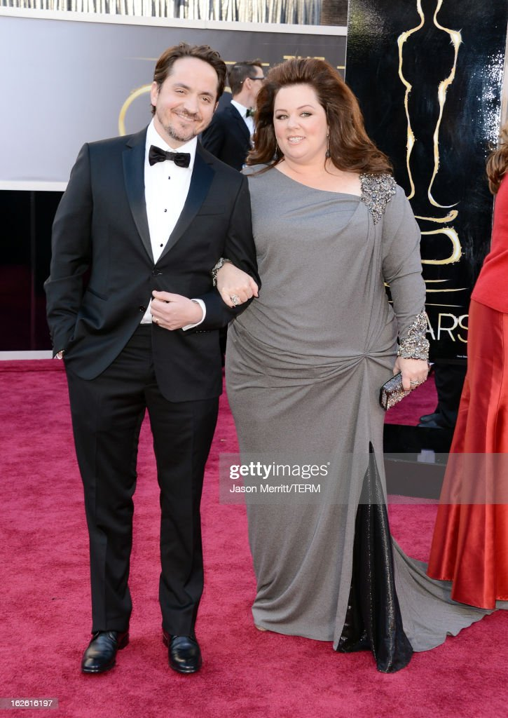 Actress Melissa McCarthy (R) and actor <a gi-track='captionPersonalityLinkClicked' href=/galleries/search?phrase=Ben+Falcone&family=editorial&specificpeople=4068633 ng-click='$event.stopPropagation()'>Ben Falcone</a> arrive at the Oscars at Hollywood & Highland Center on February 24, 2013 in Hollywood, California.