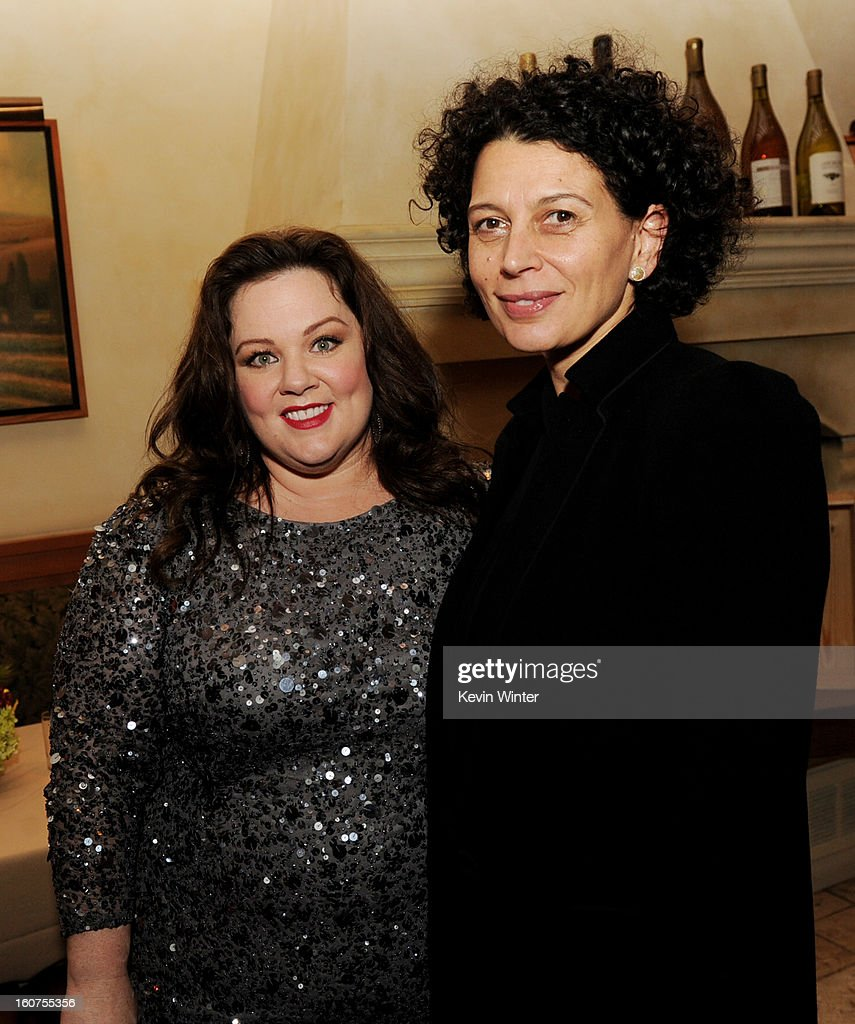 Actress Melissa McCarthy (L) and Donna Langely, Co-Chairman, Universal Pictures pose at the after party for the premiere of Universal Pictures' 'Identity Thief' at Napa Valley Grille on February 4, 2013 in Los Angeles, California.