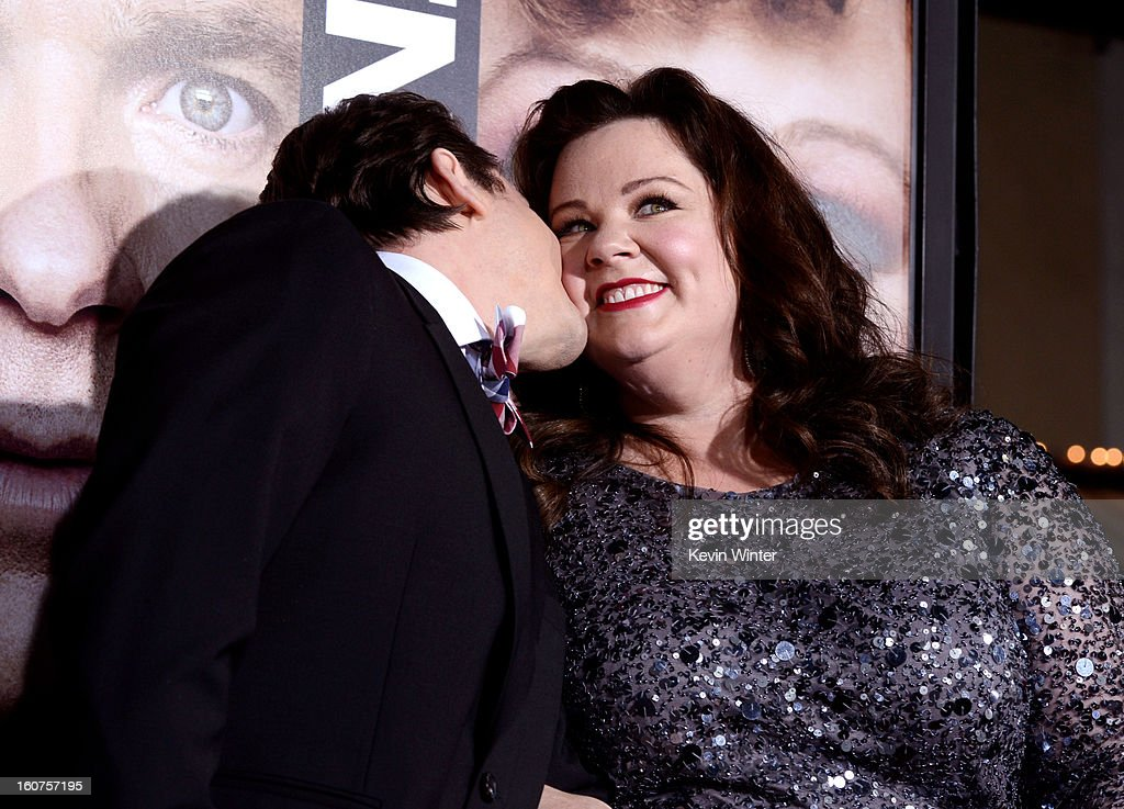 Actress Melissa McCarthy (R) and her husband Ben Falcone arrive at the premiere of Universal Pictures' 'Identity Thief' at the Village Theatre on February 4, 2013 in Los Angeles, California.