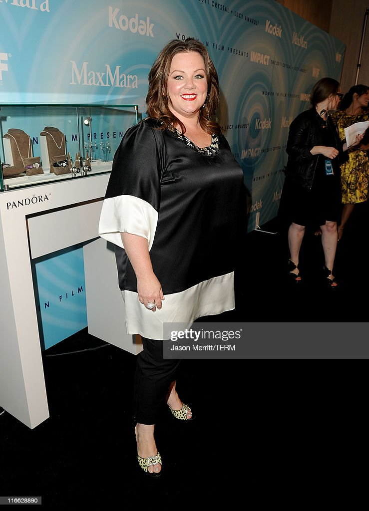 Actress <a gi-track='captionPersonalityLinkClicked' href=/galleries/search?phrase=Melissa+McCarthy&family=editorial&specificpeople=880291 ng-click='$event.stopPropagation()'>Melissa McCarthy</a> arrives at the 2011 Women In Film Crystal + Lucy Awards with presenting sponsor PANDORA jewelry at the Beverly Hilton Hotel on June 16, 2011 in Beverly Hills, California.