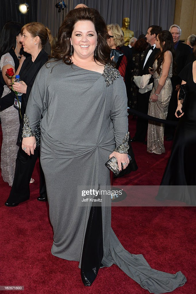 Actress <a gi-track='captionPersonalityLinkClicked' href=/galleries/search?phrase=Melissa+McCarthy&family=editorial&specificpeople=880291 ng-click='$event.stopPropagation()'>Melissa McCarthy</a> arrives at the Oscars at Hollywood & Highland Center on February 24, 2013 in Hollywood, California.