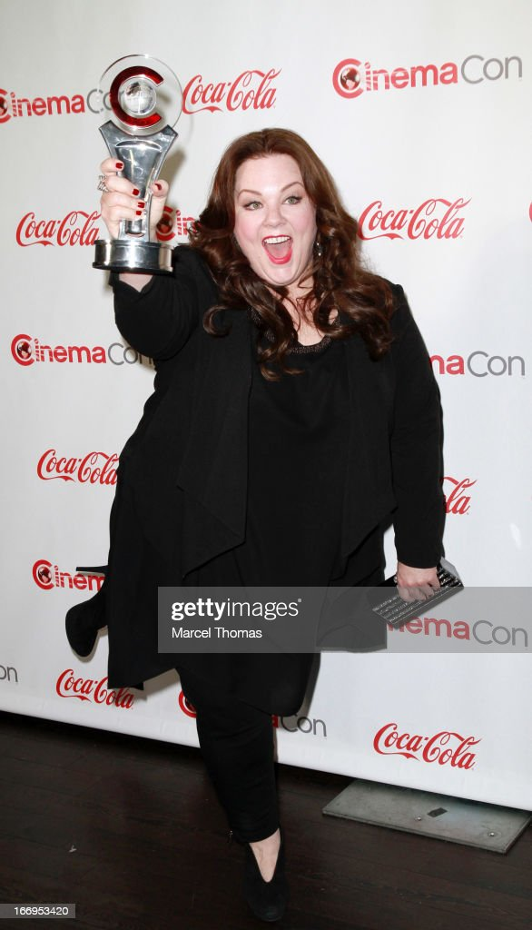 Actress <a gi-track='captionPersonalityLinkClicked' href=/galleries/search?phrase=Melissa+McCarthy&family=editorial&specificpeople=880291 ng-click='$event.stopPropagation()'>Melissa McCarthy</a>, recipient of the Female Star of the Year Award , arrives at the CinemaCon Big Screen Achievement Awards at the Pure Nightclub at Caesars Palace during CinemaCon 2013 on April 18, 2013 in Las Vegas, Nevada.