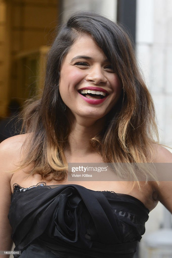Actress Melonie Diaz arrives at the Marchesa runway show during Mercedes-Benz Fashion Week Spring 2014 at The New York Public Library on September 11, 2013 in New York City.