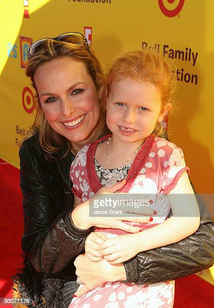 Actress Melora Hardin and her daughter attends the PS ARTS ''Express Yourself 2009'' at Barker Hangar on November 15 2009 in Santa Monica California