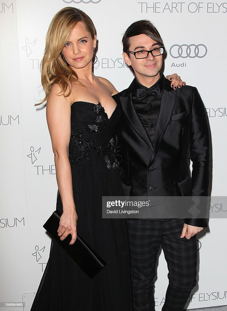 Actress Mena Suvari (L) and designer Christian Siriano attend the Art of Elysium's 6th Annual Black-tie Gala 'Heaven' at 2nd Street Tunnel on January 12, 2013 in Los Angeles, California.