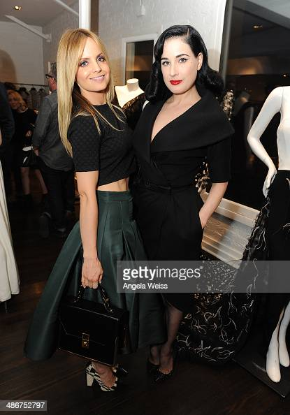 Actress Mena Suvari and Dita Von Teese attend Christian Siriano Fall 2014 LA preview cocktail party at Decades on April 25 2014 in Los Angeles...