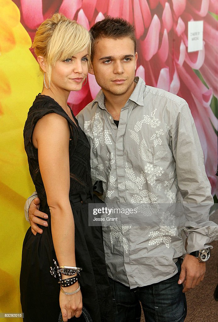 Actress Mena Suvari (L) and music producer Simone Sestito attend the Spring 2009 Mercedes-Benz Fashion Week held at Smashbox Studios on October 14, 2008 in Culver City, California.