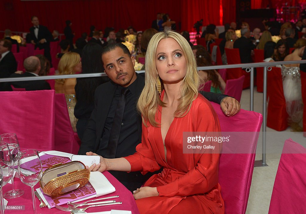 Actress Mena Suvari (R) and Salvador Sanchez attend Neuro at 21st Annual Elton John AIDS Foundation Academy Awards Viewing Party at West Hollywood Park on February 24, 2013 in West Hollywood, California.