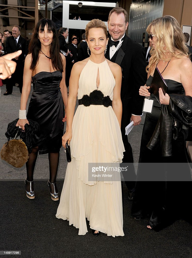 Actress <a gi-track='captionPersonalityLinkClicked' href=/galleries/search?phrase=Mena+Suvari&family=editorial&specificpeople=156413 ng-click='$event.stopPropagation()'>Mena Suvari</a> arrives at the 40th AFI Life Achievement Award honoring Shirley MacLaine held at Sony Pictures Studios on June 7, 2012 in Culver City, California. The AFI Life Achievement Award tribute to Shirley MacLaine will premiere on TV Land on Saturday, June 24 at 9PM ET/PST.