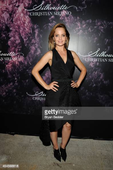 Actress Mena Suvari attends Christian Siriano's celebration of his new fragrance with a Stoli Vodka cocktail at the designer's popup Silhouette...