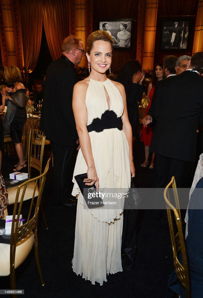 Actress <a gi-track='captionPersonalityLinkClicked' href=/galleries/search?phrase=Mena+Suvari&family=editorial&specificpeople=156413 ng-click='$event.stopPropagation()'>Mena Suvari</a> attends the 40th AFI Life Achievement Award honoring Shirley MacLaine held at Sony Pictures Studios on June 7, 2012 in Culver City, California. The AFI Life Achievement Award tribute to Shirley MacLaine will premiere on TV Land on Saturday, June 24 at 9PM