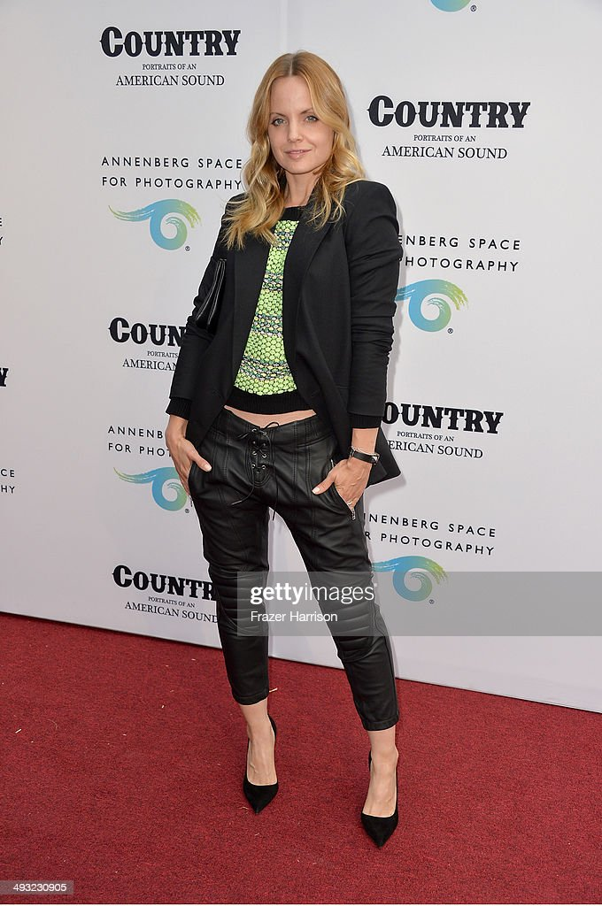 Actress Mena Suvari attends the Annenberg Space for Photography Opening Celebration for 'Country, Portraits of an American Sound' at the Annenberg Space for Photography on May 22, 2014 in Century City, California.