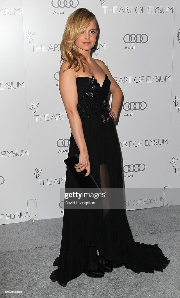 Actress Mena Suvari attends the Art of Elysium's 6th Annual Black-tie Gala 'Heaven' at 2nd Street Tunnel on January 12, 2013 in Los Angeles, California.
